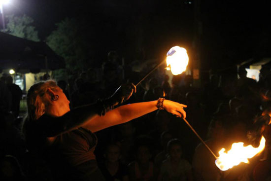 Fire poi spinning, flow arts
